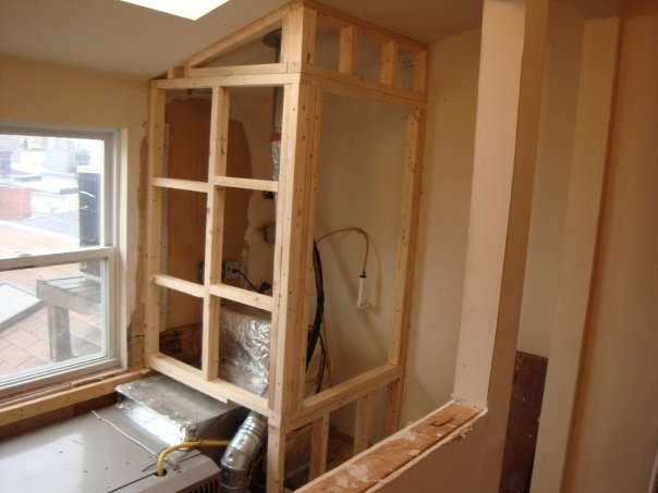 building furnace enclosure for storage Fells Point rowhome 3rd floor Framing around the furnace; screwed not glued