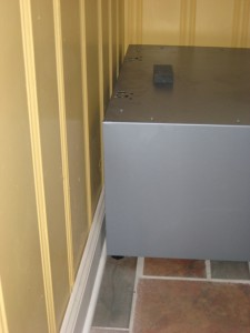 removing back of dryer pedestal allows it to slip tight to wall
