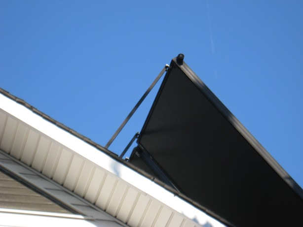 solar thermal :: close up of residential solar panels - black aluminum boxes