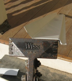 Wiss hand seamer at work on aluminum flashing