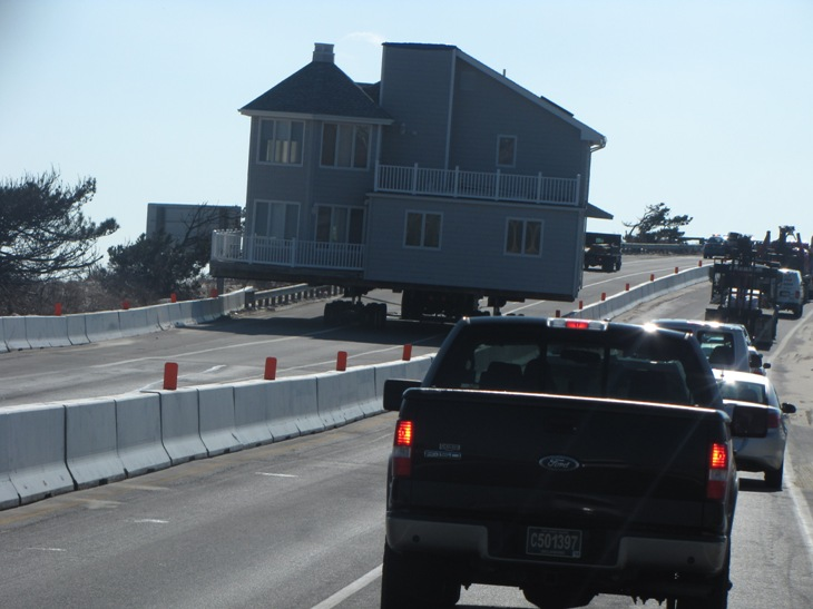 large house being transported by tractor trailer along the coast of Delaware