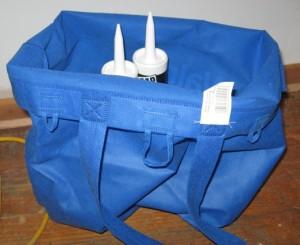 solution caulk tubes inside a reusable canvas bag