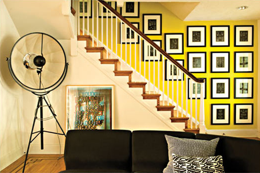 front stairwell vintage studio lamp and Kosta Boda display book prints image via BaltimoreStyleMag
