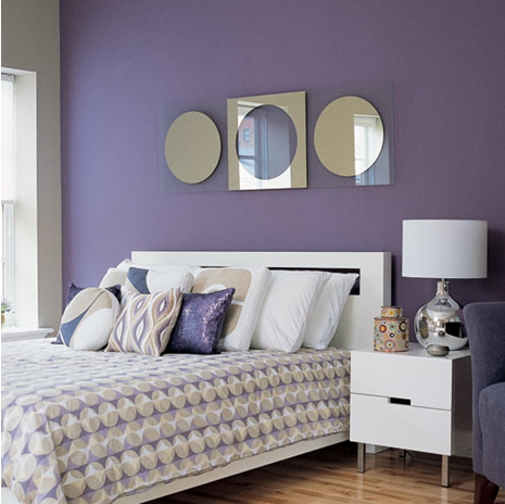 a set of artistic mirrors modern headboard on a lavender wall