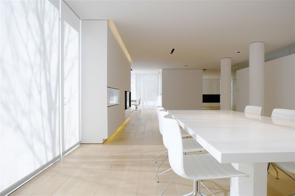 large window lit modern space white table image via Ana M. Manzo