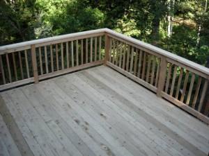 large empty cedar deck weathered image via Ricks Fencing