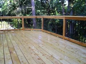 large cedar deck refinished image via Ricks Fencing
