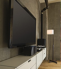 low profile TV mounted over a white credenza