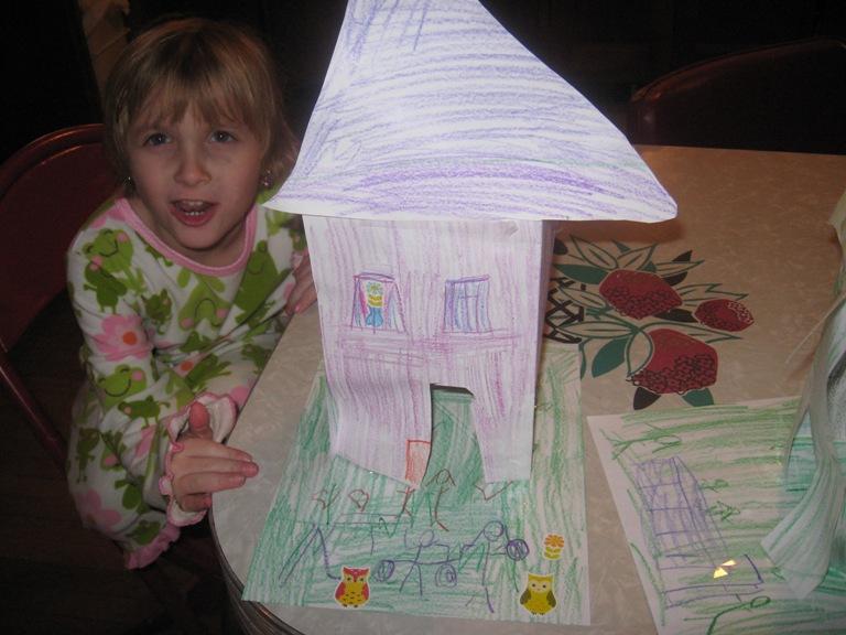 Eva critiquing seven-year-old Evyn's design