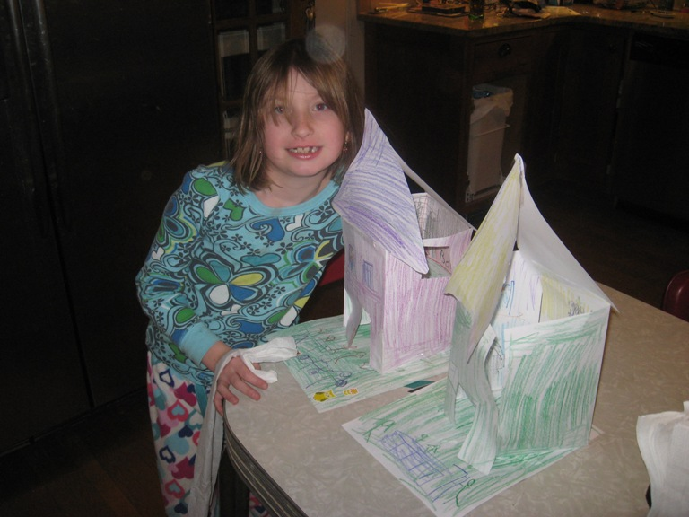 Evyn presenting her new house models