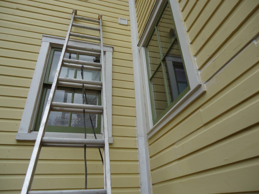 ladder at windows wood trim and siding caulked