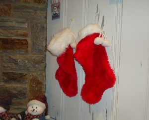 Christmas Stockings Hung on a Wall by a Fireplace