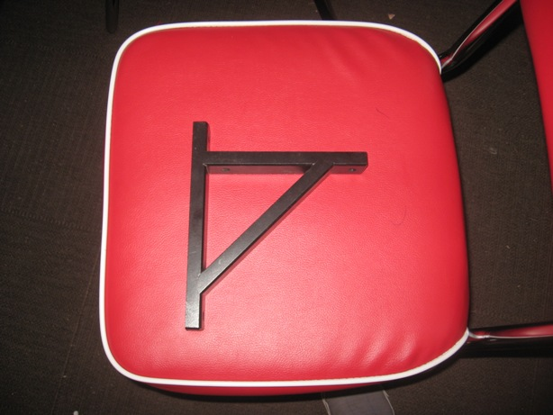 Black Shelf Bracket from IKEA on a Red Chair