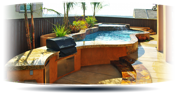 Stone Above Ground Pool Integrated Grill image via premierpoolsandspas.com