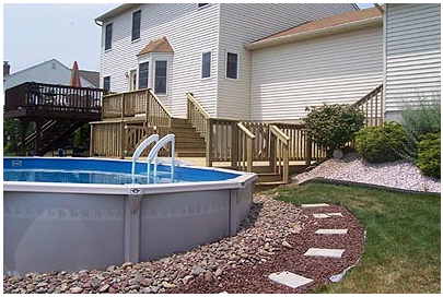 An above ground pool deck offers outdoor living for Pool design for sloped yard