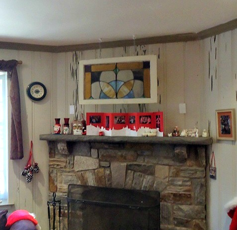 Salvaged Stained Glass Window Hung over Fireplace