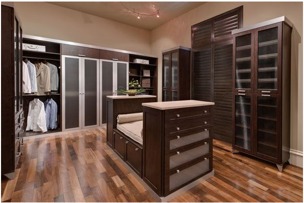 Custom Closets Large Walk In Closet Brown Theme With Seat Area