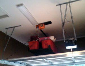 Motorized Cable Rack above Garage Door