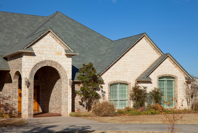 Selecting roof colors to complement brick or stone exteriors for Brick selection for houses