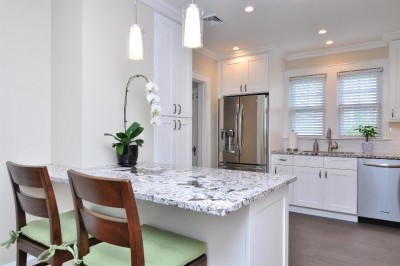 consider an island, a peninsula or a desk when buying kitchen cabinets