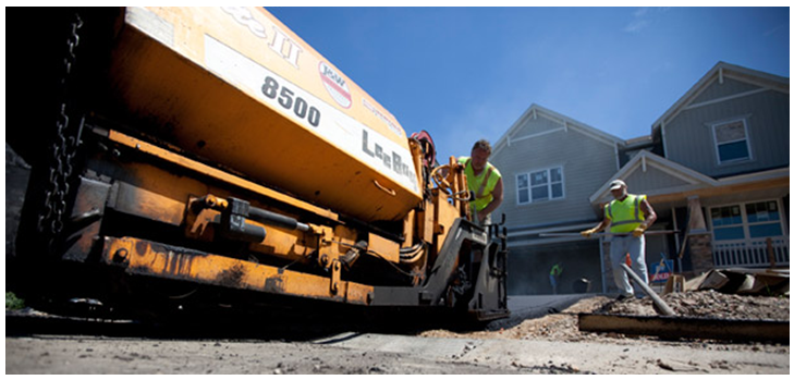 Benefits of Asphalt Driveways :: Men Working on an Asphalt Paver
