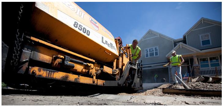 Benefits of Asphalt Driveways :: Men Working on an Asphalt Paver
