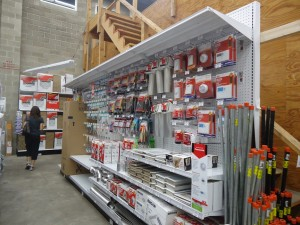 Baltimore's Newest Ace Hardware :: woman walks the aisles Canton Ace Hardware