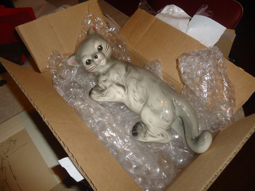 ceramic climbing cat in bubble wrap box