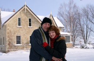 couple outside winter home via iStock