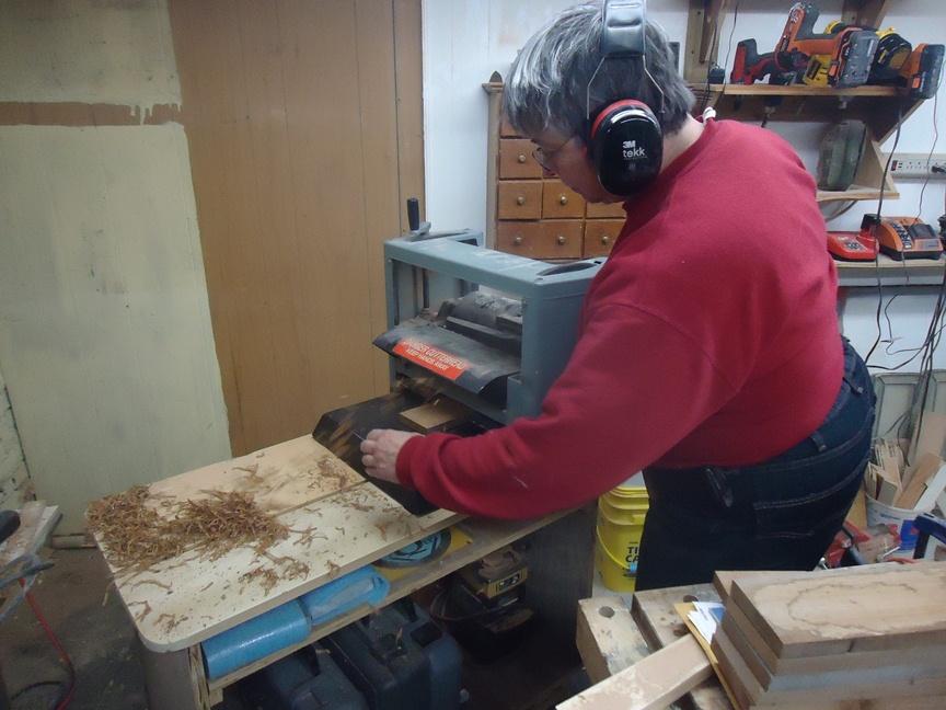 Beth running cedar through table planer