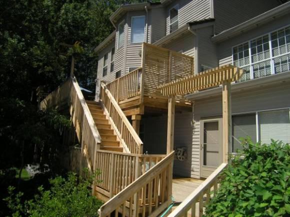 large cedar deck on a hillside