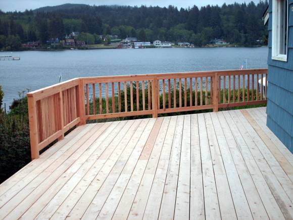 code requirements for decks :: large wood deck overlooking water