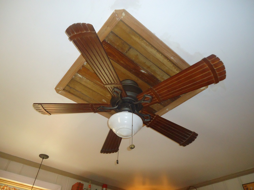 paneled ceiling detail at ceiling fan