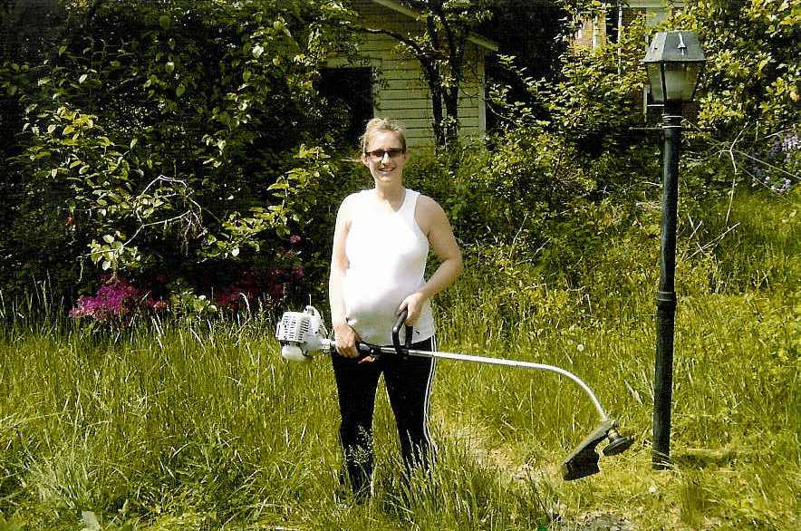 pregnant lady overgrown yard with weedwacker mothers day