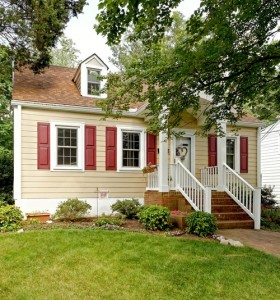 traditional exterior tan paint red shutters white trim