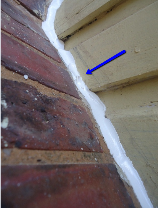 smoothing caulk with pull off point