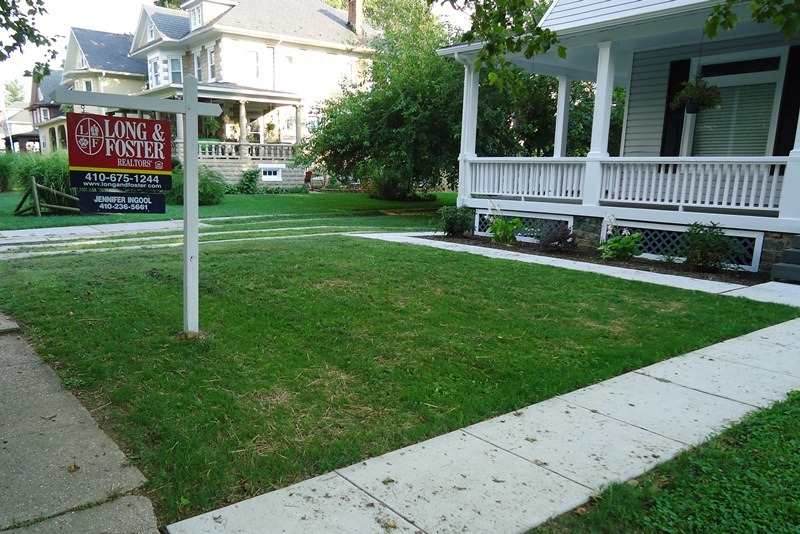 newly seeded lawn yard sign home for sale