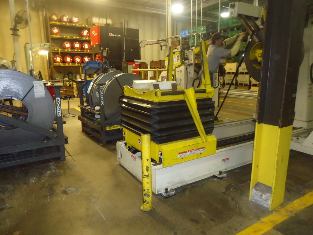 Coil Steel Fed into Stamping Machine John Deere Horicon Works