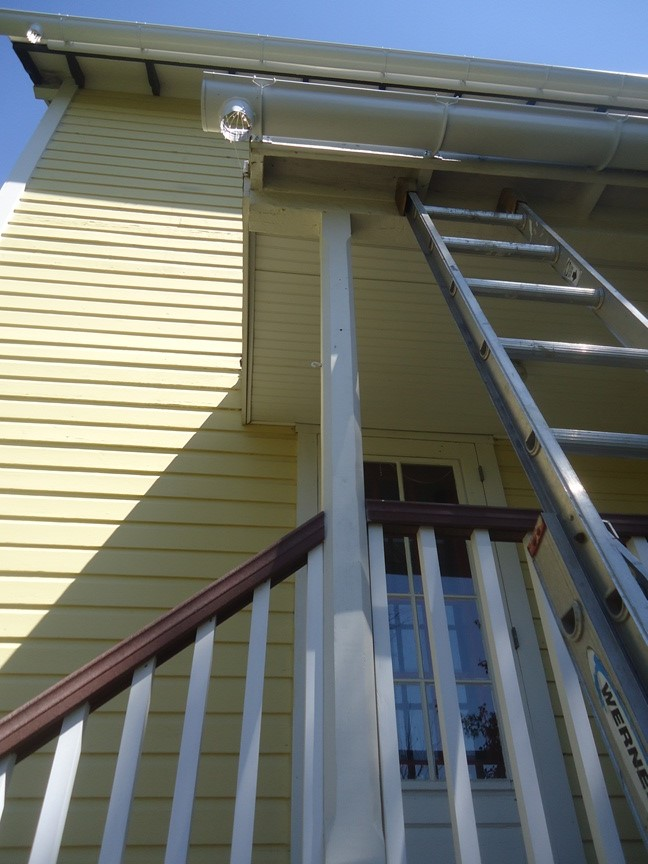 Installing Half Round Gutters And Downspouts On A