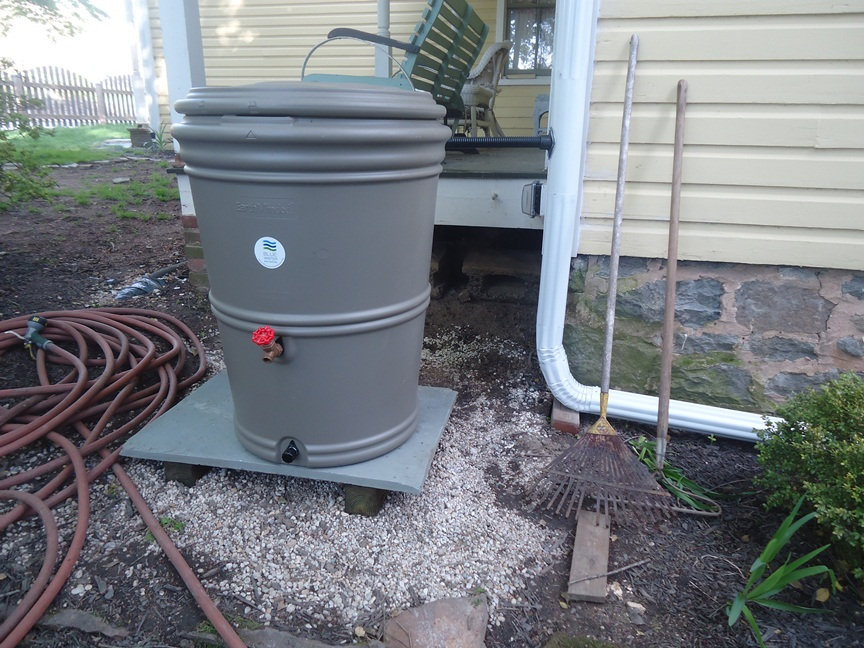 rain barrel set on spare blue stone slab