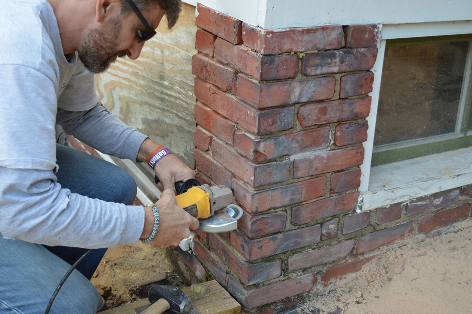Prepping brick with grinder