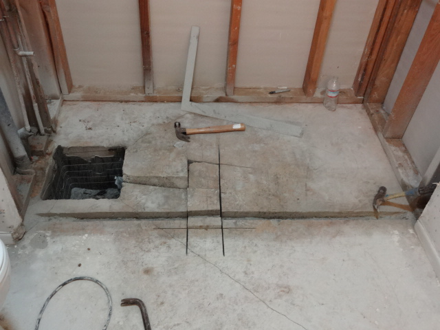 Removing Old Shower Drain Cutting For Inline Concrete Cut