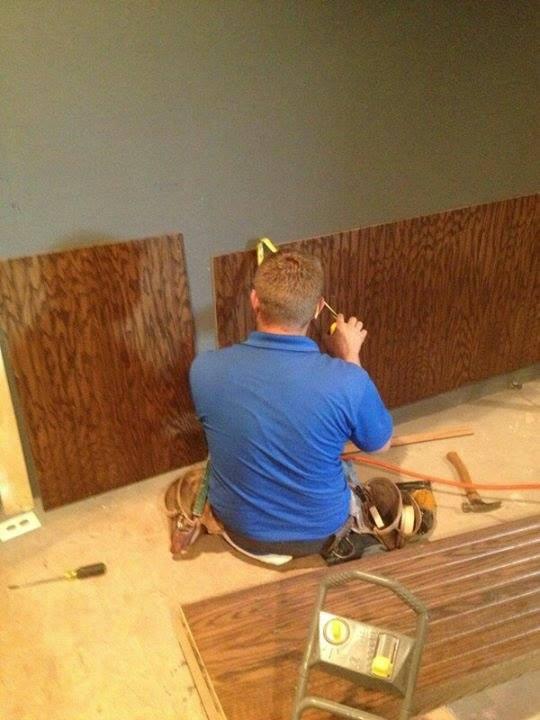 Aaron Gillison hanging beaded paneling