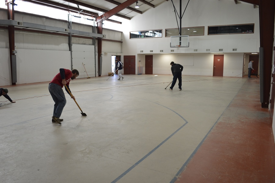 floor prep with scrapers and leaf blowers