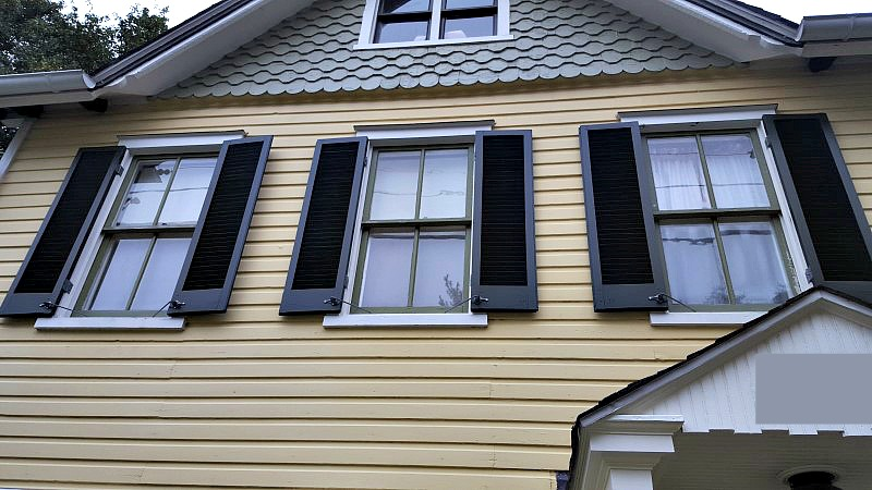 Refinishing hanging functional exterior wood shutters exteriors for Exterior louvered window shutters