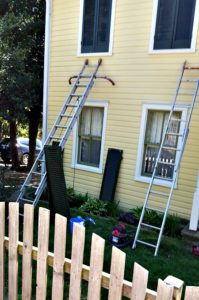 preparing to hang shutters